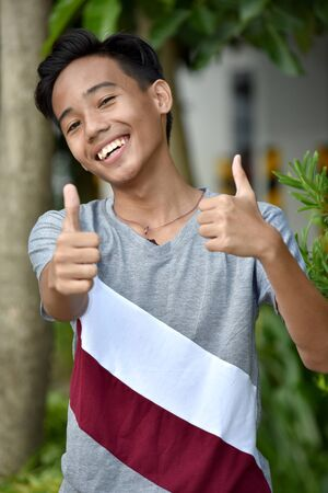 Young Minority Boy With Thumbs Up