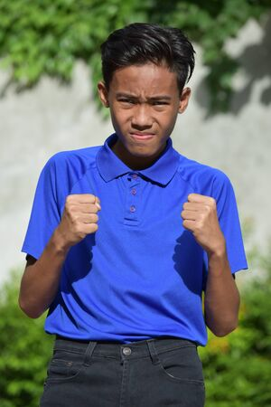 An Angry Young Asian Male Juvenile