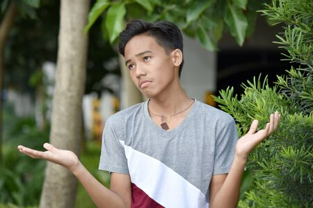 An Undecided Filipino Male Youngster Stock Photo