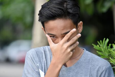 A Stressed Young Filipino Male