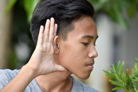 A Youthful Minority Male Listening