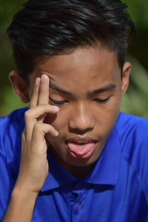 An Asian Teenager Boy And Illness
