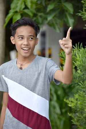 An An Asian Boy Pointing 스톡 콘텐츠