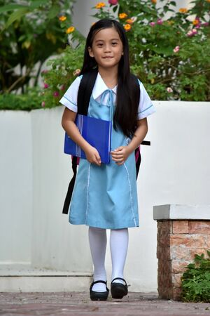 Standing Catholic Girl Student Wearing Uniform 免版税图像
