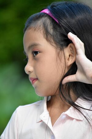 A Petite Filipina Girl Child Hearing
