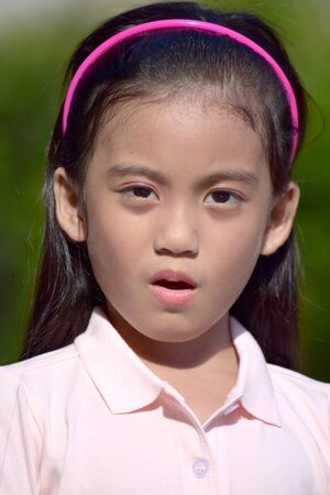 A Confused Beautiful Filipina Female Adolescent