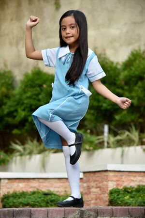 A Pretty Minority Girl Student Dancing
