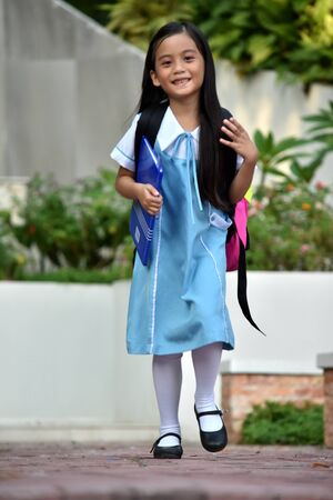 A Walking Young Female Student