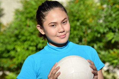 A Cute Female Volleyball Player With Volleyball