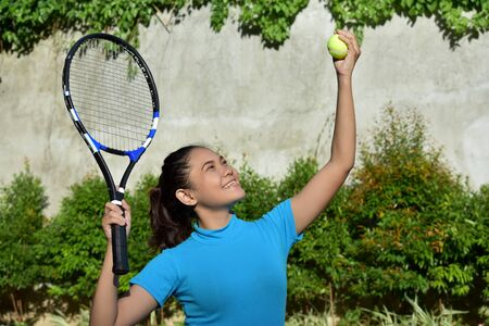 Tennis Player And Happiness With Tennis Racket 写真素材