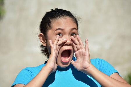 A Youthful Asian Female Shouting
