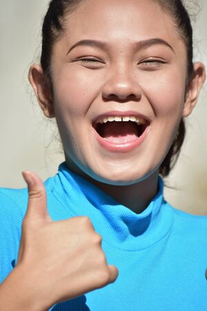 A Filipina Female With Thumbs Up