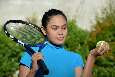 Cute Fit Asian Female Tennis Player With Tennis Racket
