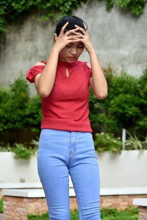 An Asian Girl Under Stress