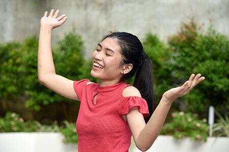 Beautiful Filipina Female Making A Decision