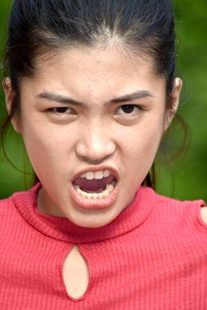 Youthful Filipina Teenager Girl Under Stress 写真素材