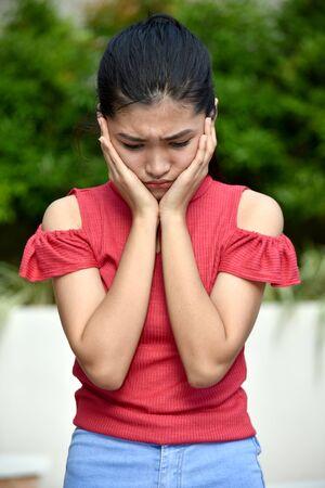 A Depressed Young Filipina Female Juvenile