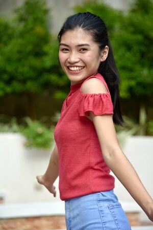 Youthful Filipina Teenage Female And Happiness