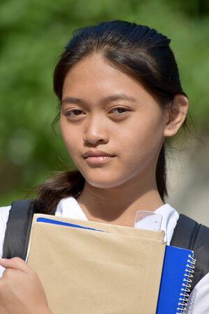 An Unemotional Student Teenager School Girl