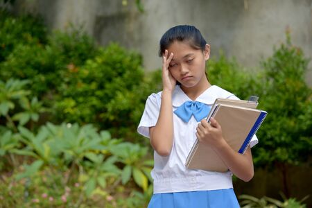 Tired Filipina Girl Student With School Books