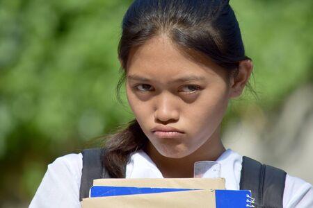 An Unhappy Teen Student School Girl