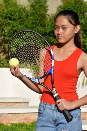 Unemotional Athletic Diverse Girl Tennis Player With Tennis Racket