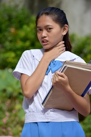 Pretty Diverse Student Teenager School Girl Choking With School Books