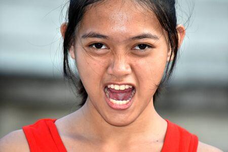 A Stressed Youthful Filipina Female Juvenile