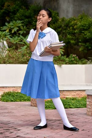 A Youthful Asian School Girl Thinking