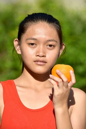 Unemotional Beautiful Diverse Female With Fruit