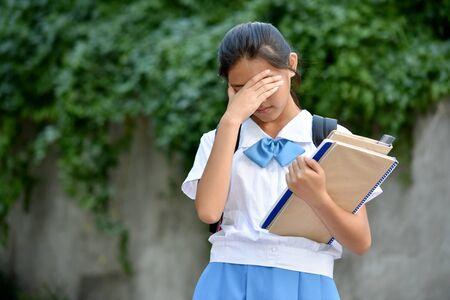 An Unhappy Young Filipina School Girl