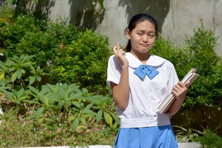 Lucky Young Filipina Girl Student With School Books