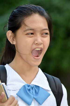 A Youthful Minority Girl Student Shouting