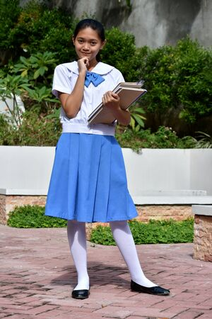 Cute Asian School Girl Thinking With School Books