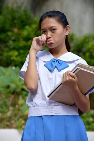 Tearful Youthful Filipina Girl Student With School Books
