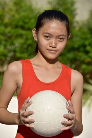 An Unemotional Female Volleyball Player With Volleyball