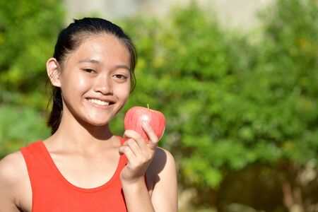 A Beautiful Girl Smiling With Apples Imagens