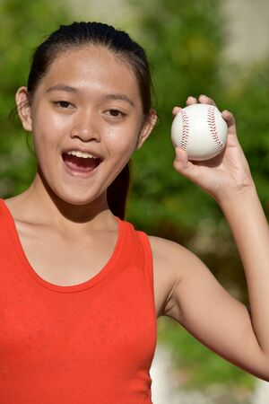 Fit Filipina Athlete And Happiness With Baseball Imagens