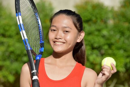 Smiling Fitness Teen Female Athlete Girl Tennis Player With Tennis Racket