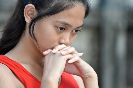 A Worried Youthful Filipina Person