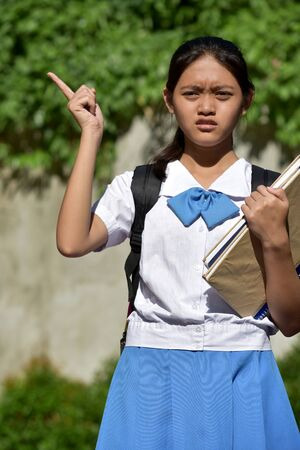 A Youthful Minority Female Student Pointing
