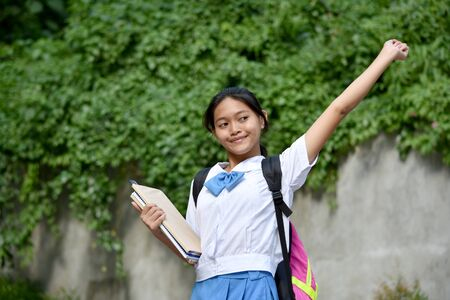 Youthful Minority School Girl And Happiness