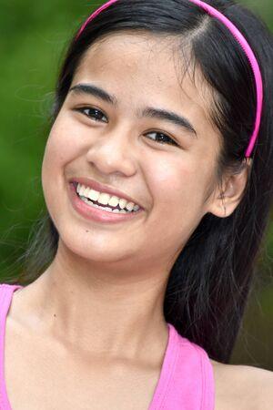 A Smiling Pretty Minority Teen Girl 스톡 콘텐츠