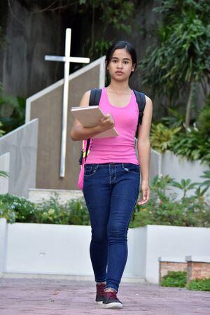 Pretty Filipina Female Student With Cross Stock Photo