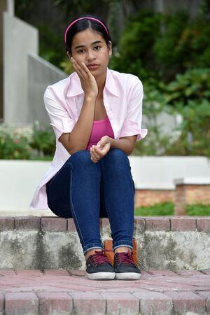An A Youthful Female And Sadness