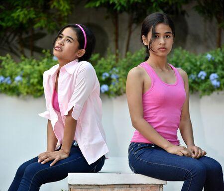 Female Teen Posing As Twin Sisters 스톡 콘텐츠
