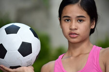 Serious Diverse Female Athlete With Soccer Ball