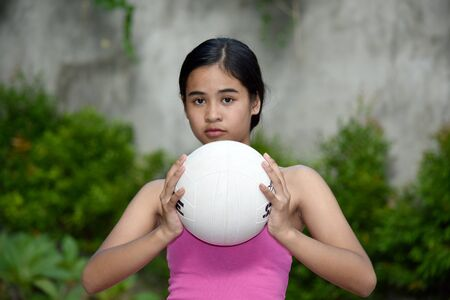 Serious Minority Female Athlete With Volleyball