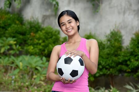 Happy Sporty Filipina Person With Soccer Ball