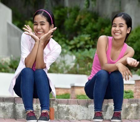 A Happy Female Teens Twin Sisters Archivio Fotografico